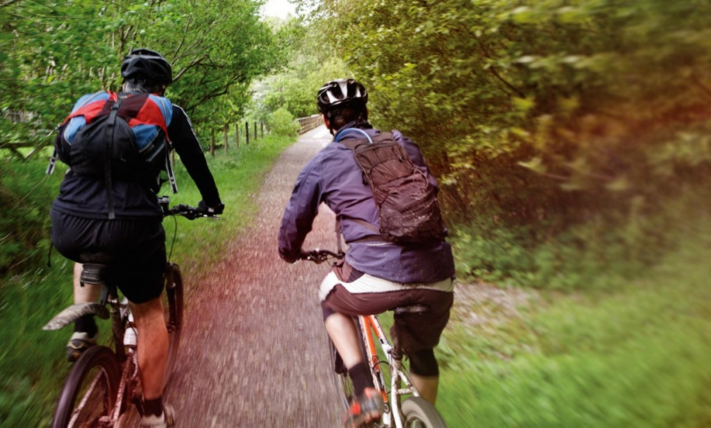 two men biking a trail